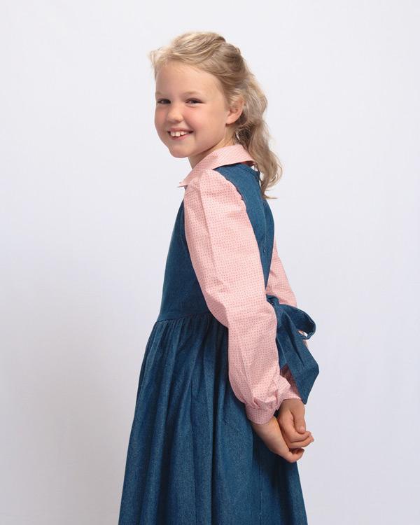 Side view of the denim jumper dress.
