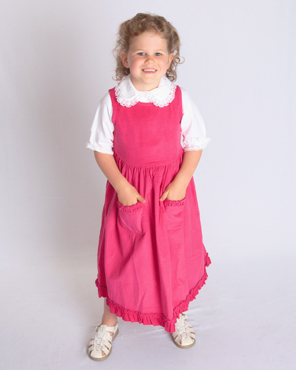 Fine wale hot pink corduroy jumper.